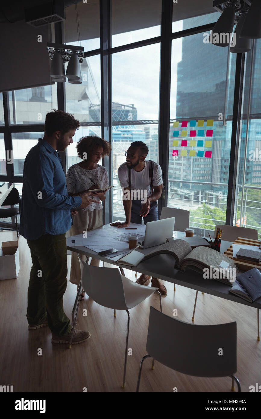 Architects interacting with each other - Stock Image