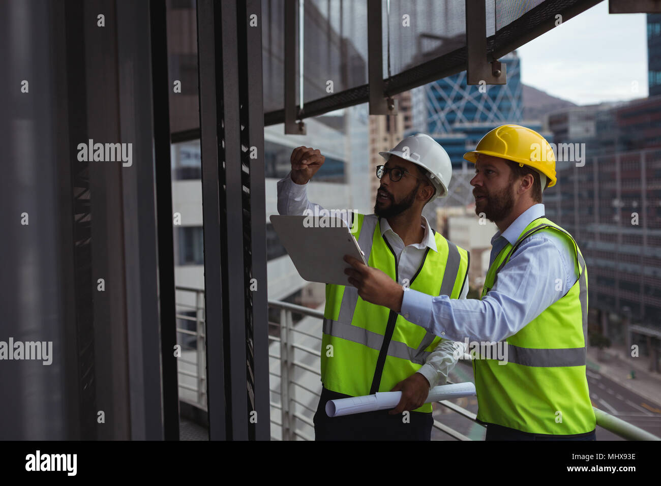 Architects discussing with each other - Stock Image