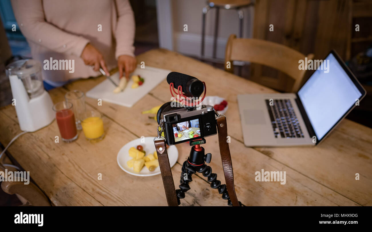 Female video blogger recording video vlog - Stock Image