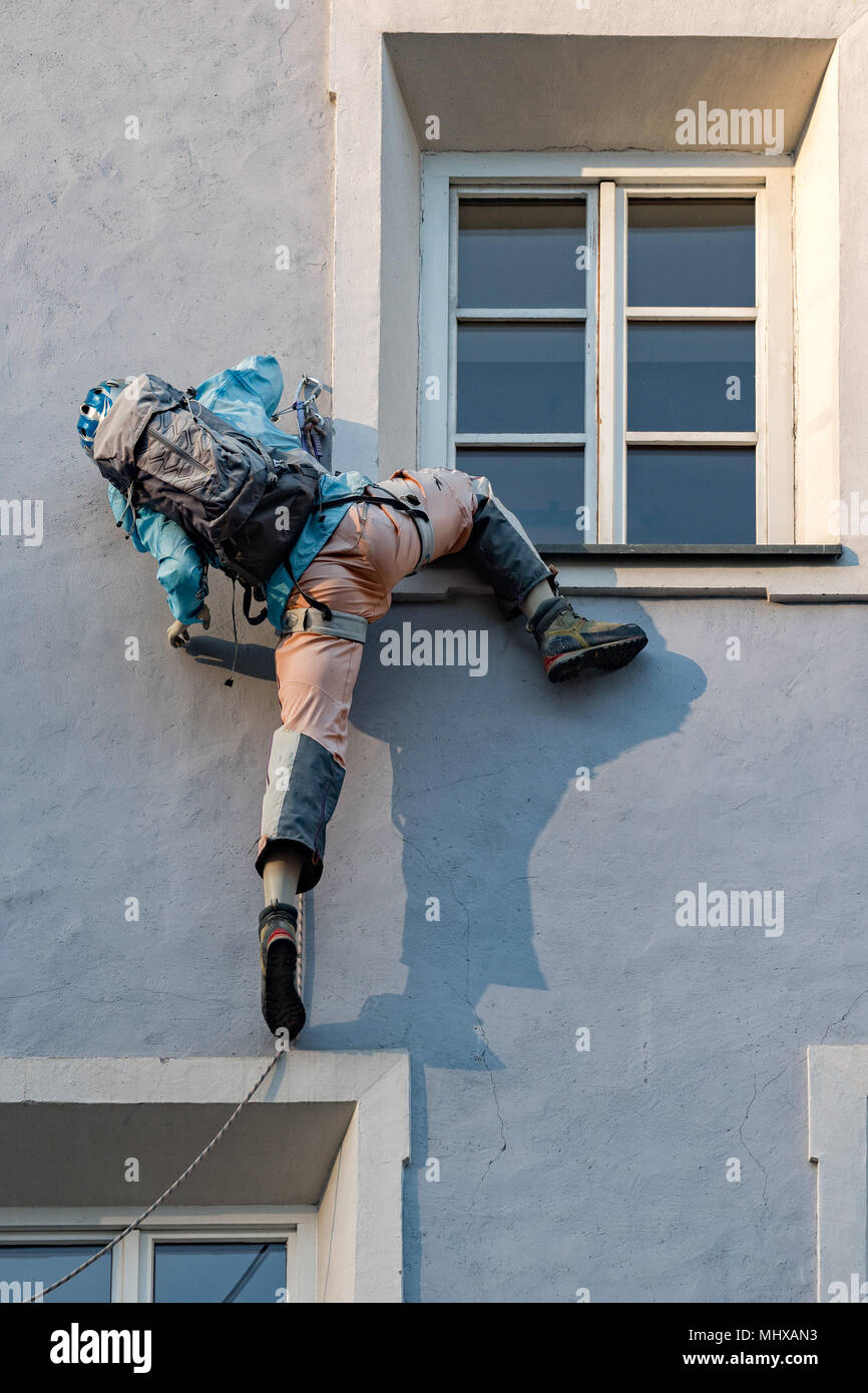 climber puppet on a building Stock Photo