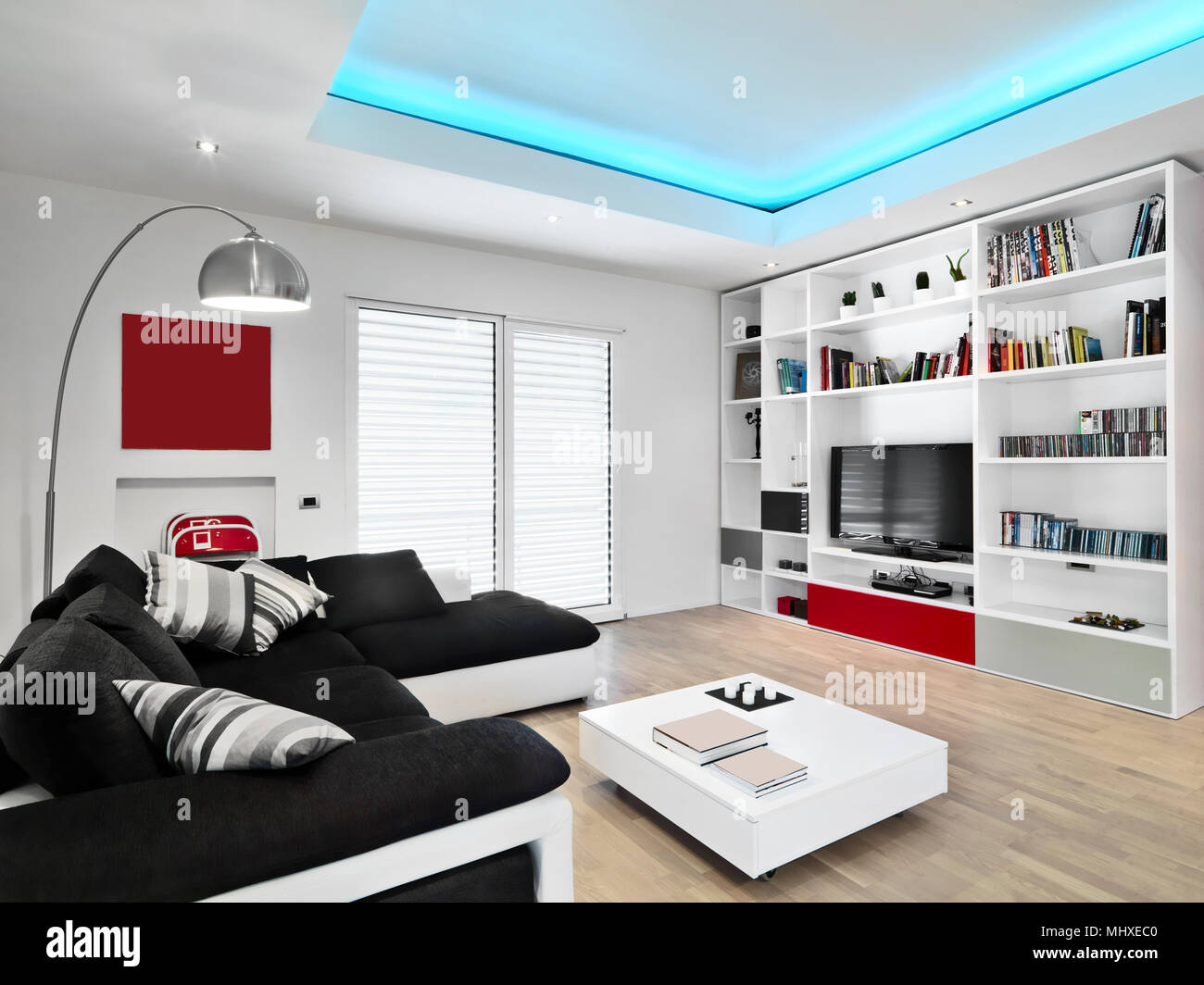 interiors shots of a modern living room with black fabric sofa and ...