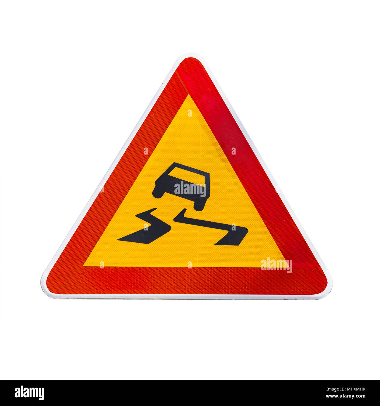 Slippery road, warning triangle road sign isolated on white background - Stock Image