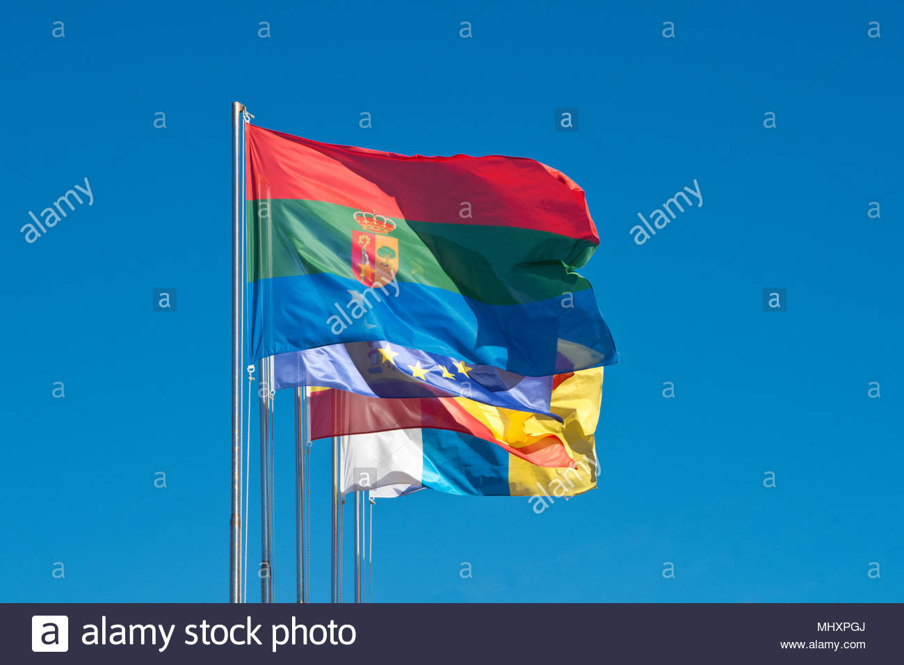 The Municipal Flag of Arona in the Canary Islands (Tenerife) with other flags - Stock Image
