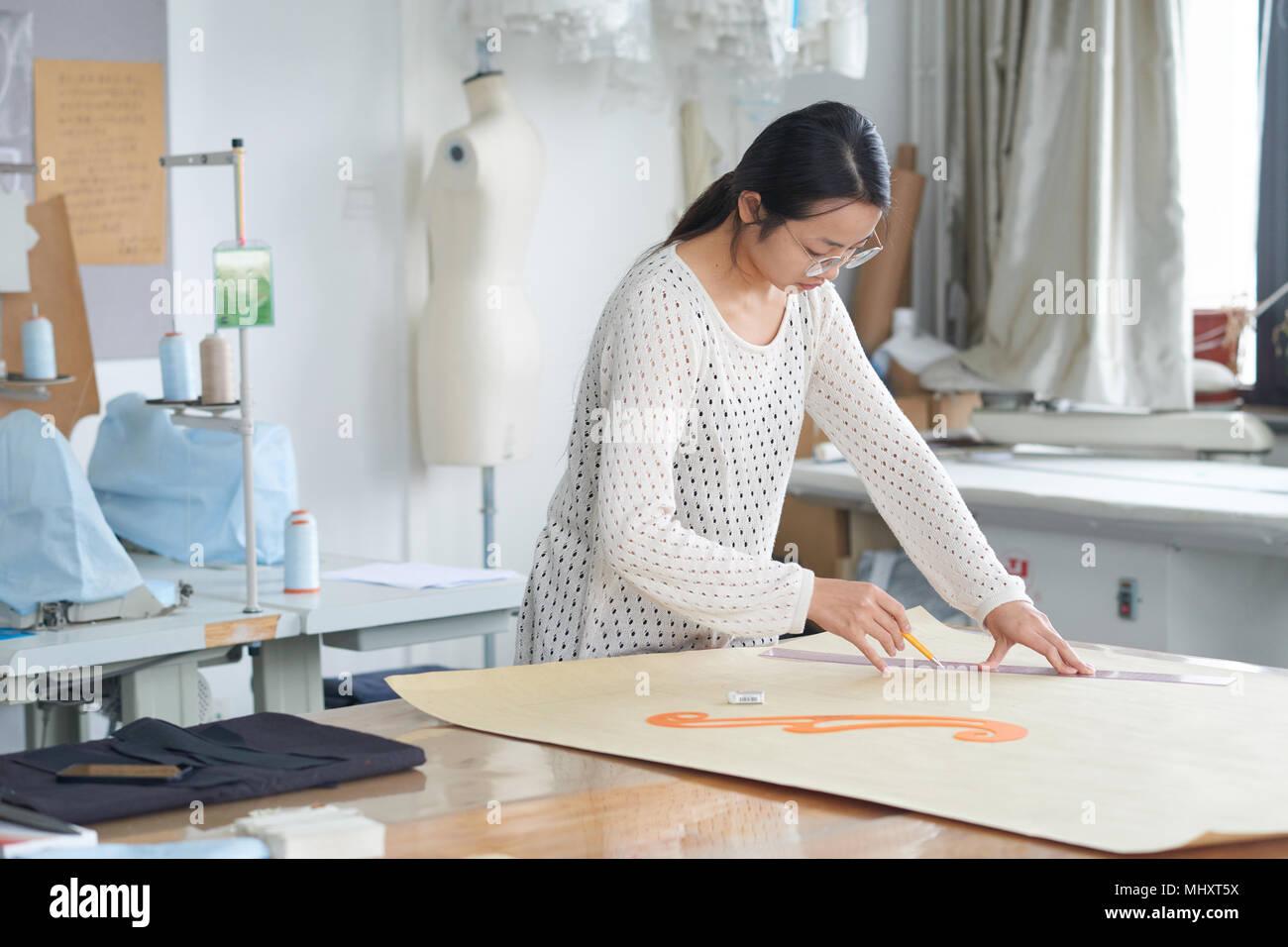 Trainee To Study Fashion Design In The Studio Stock Photo Alamy
