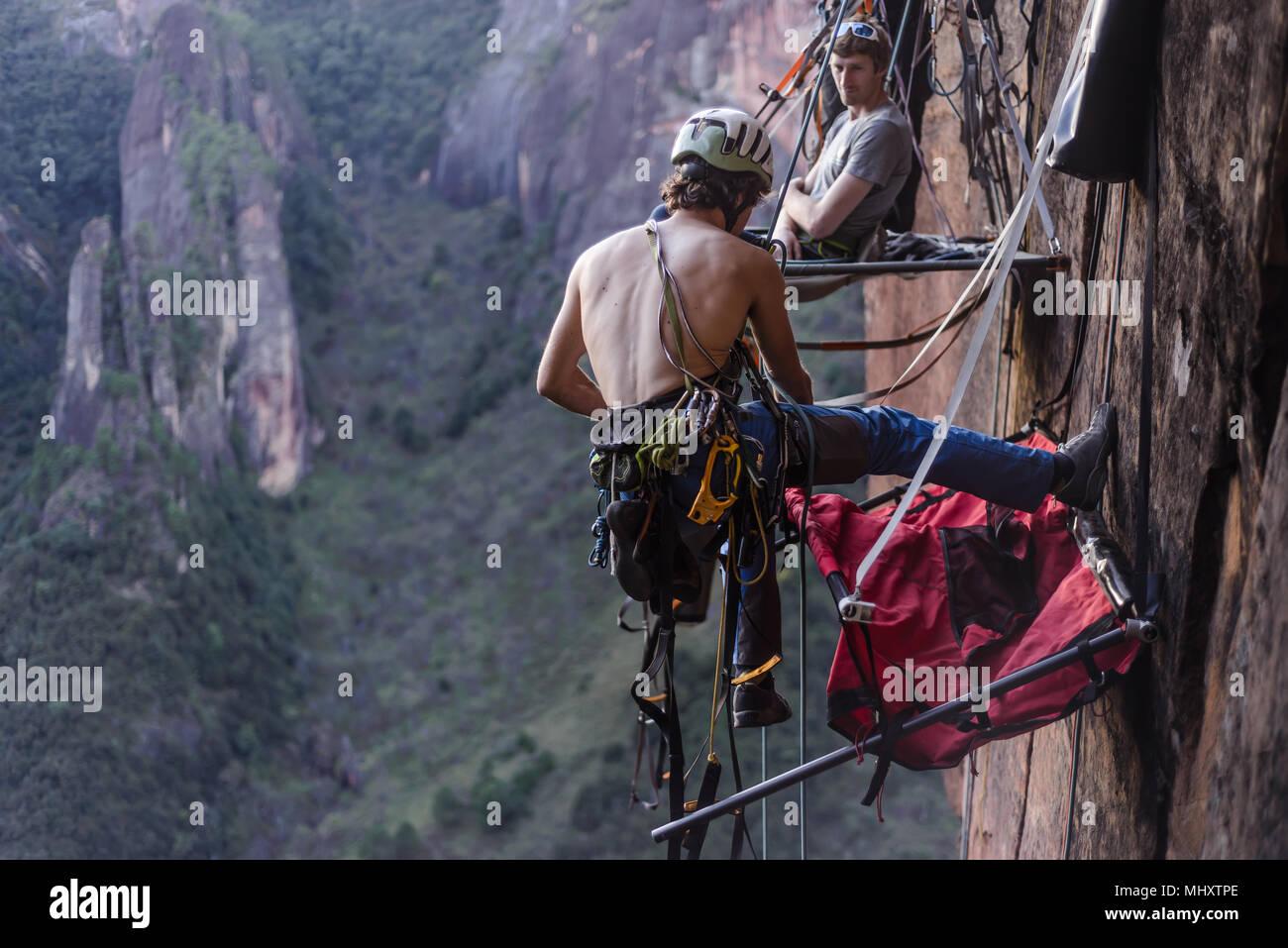 Rock climber securing portaledge, Liming, Yunnan Province, China - Stock Image
