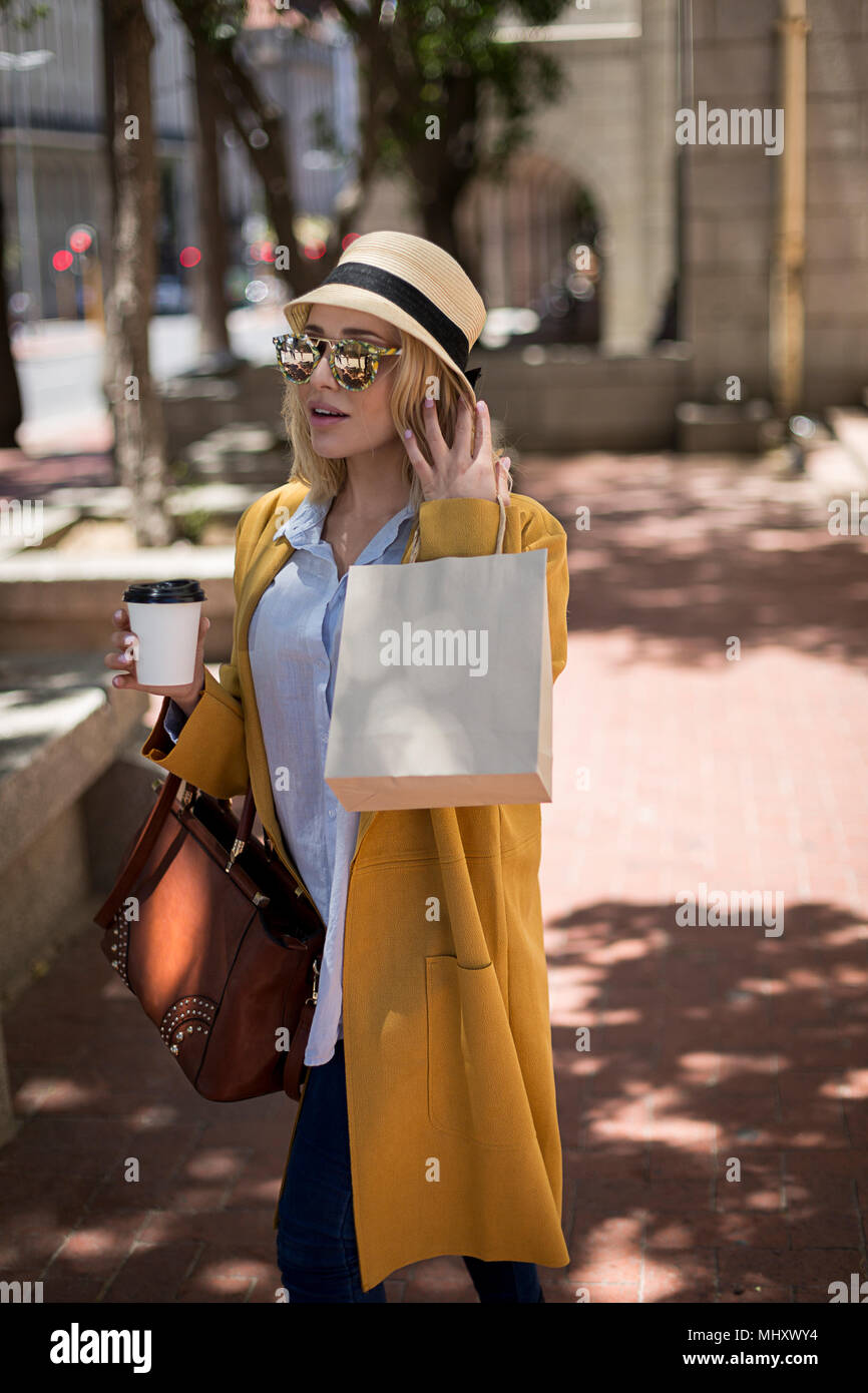 Woman shopping, Cape Town, South Africa - Stock Image