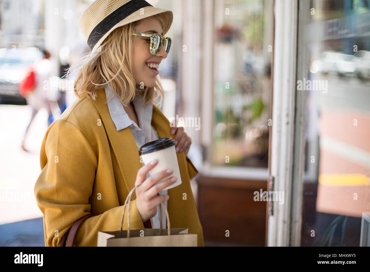 Woman window shopping, Cape Town, South Africa - Stock Image