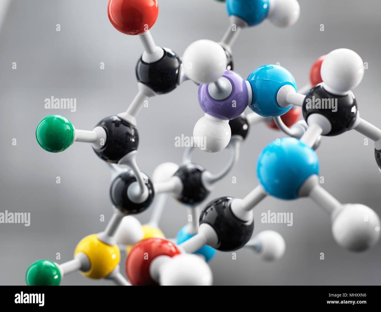 Still life of a ball and stick model illustrating a chemical formula used in research - Stock Image