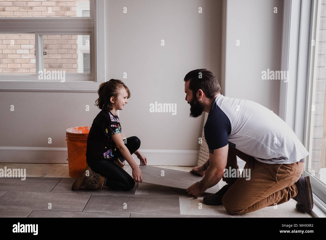 Girl Helping Father Install Floor Tiles Stock Photo 183144614 Alamy