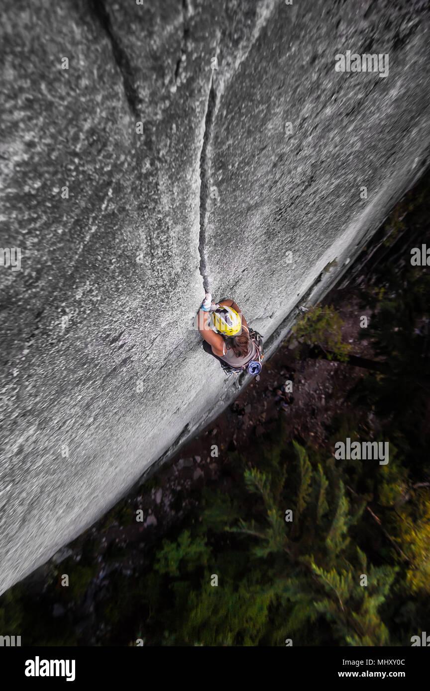 Woman trad climbing at The Chief, Squamish, Canada - Stock Image