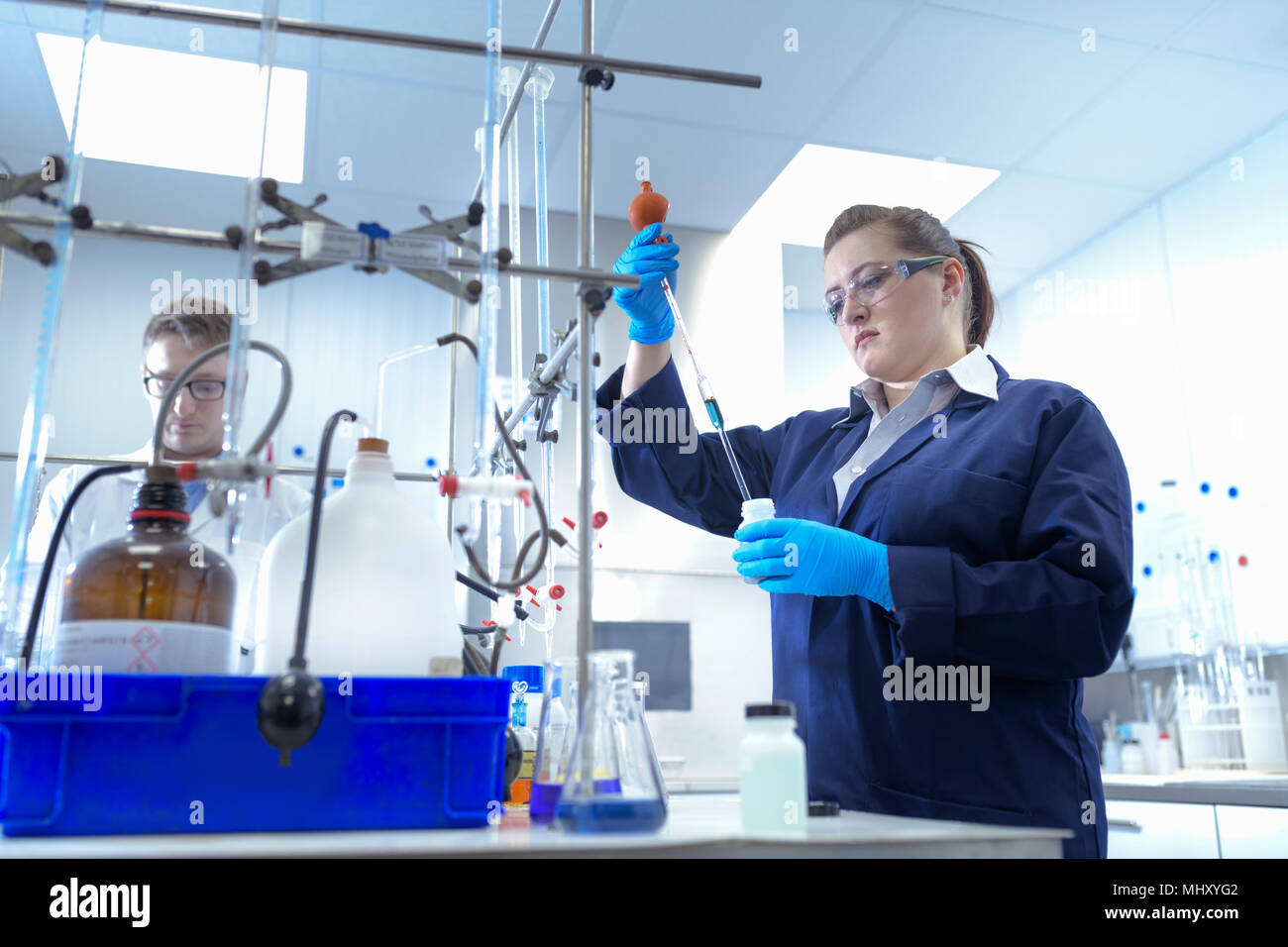 Scientists in laboratory testing chemicals in electroplating factory - Stock Image