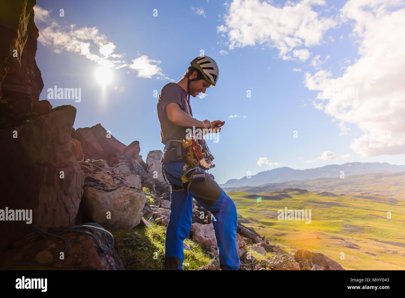 Young male climber preparing to climb, Narsaq, Vestgronland, South Greenland - Stock Image