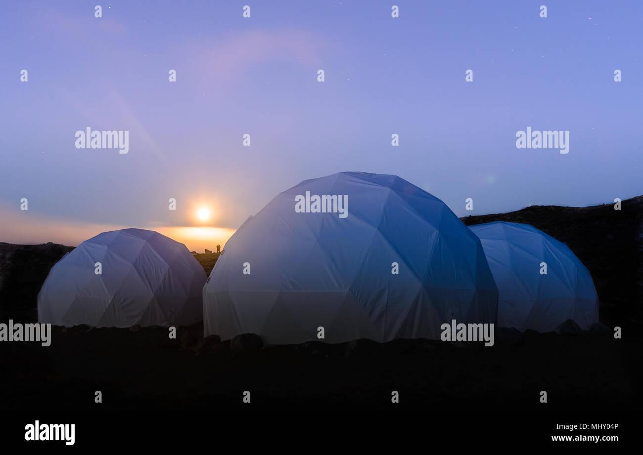 Three white dome tents at sunset, Narsaq, Vestgronland, South Greenland - Stock Image