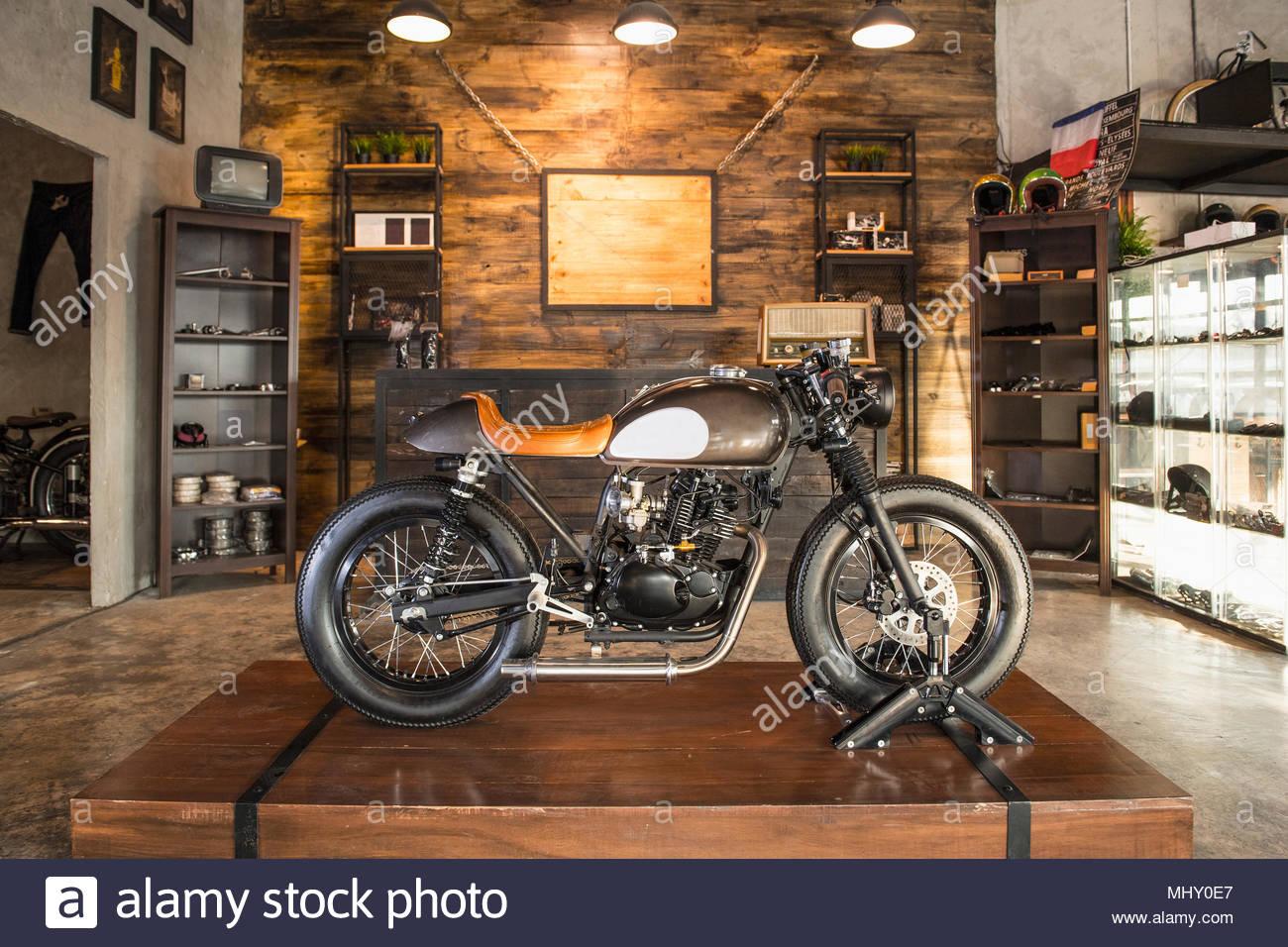 cafe racer motorbike parked inside custom motorbike shop. Black Bedroom Furniture Sets. Home Design Ideas