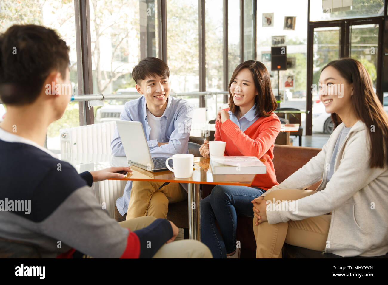 Young men and women in the coffee shop - Stock Image
