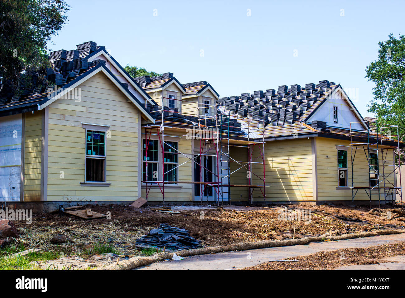 New Home Construction With Scaffolding & Roofing Materials - Stock Image
