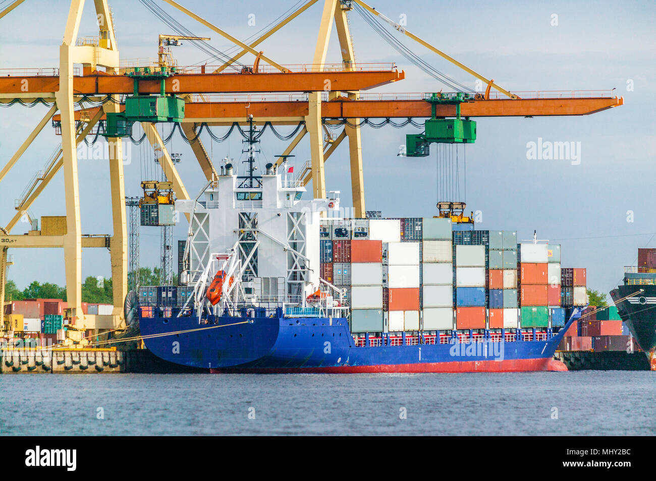 container vessel and ferry on high sea Stock Photo