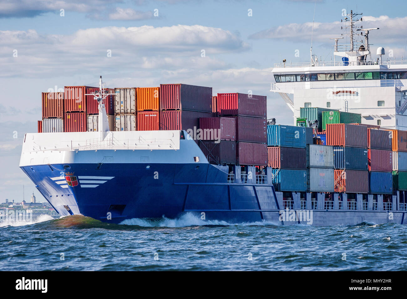 container vessel and ferry on high sea - Stock Image