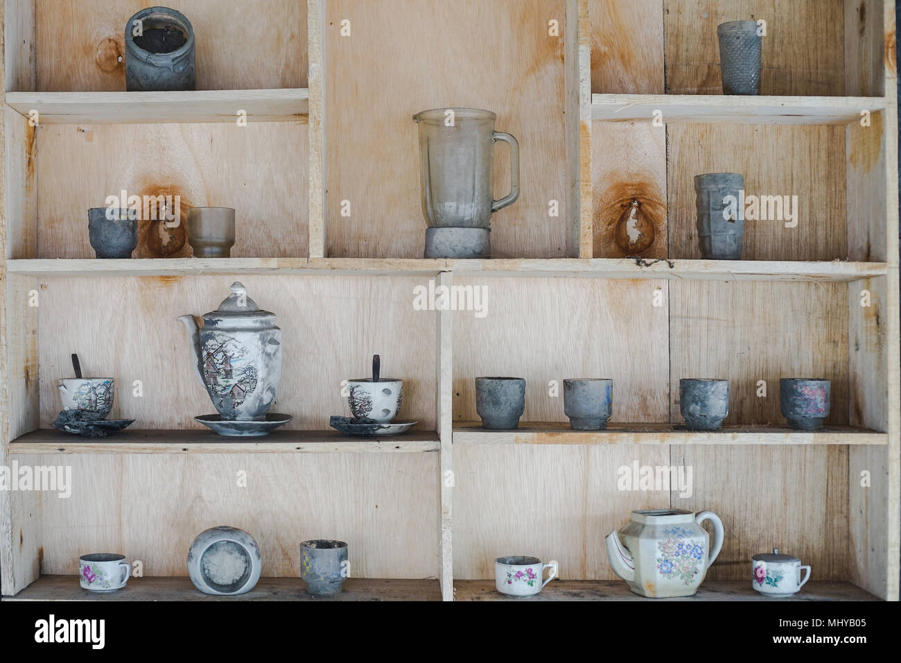 blender and cups on cabinet affected by Merapi mountain eruption - Stock Image