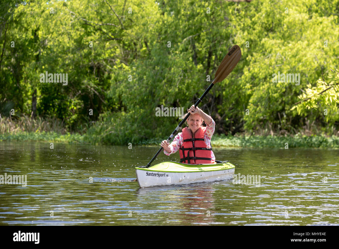 LaPlace, Louisiana - Maureen Sheahan participates in an environmental kayak tour in the Maurepas Swamp Wildlife Management Area near New Orleans. The  - Stock Image