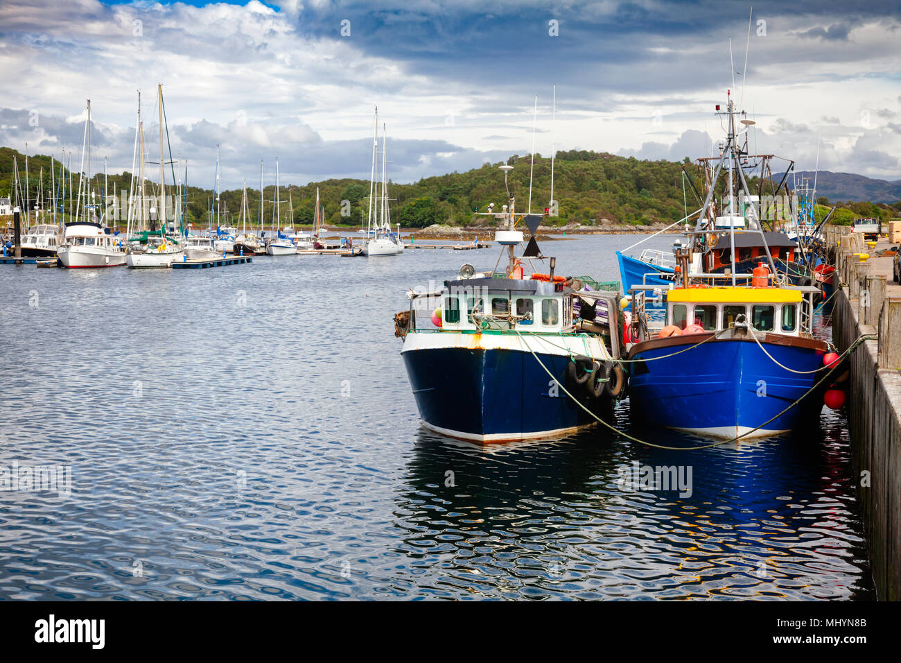 Fishing boats tied up at Tarbert, a small fishing town and ferry terminal in Argyll and Bute, Scotland, UK Stock Photo