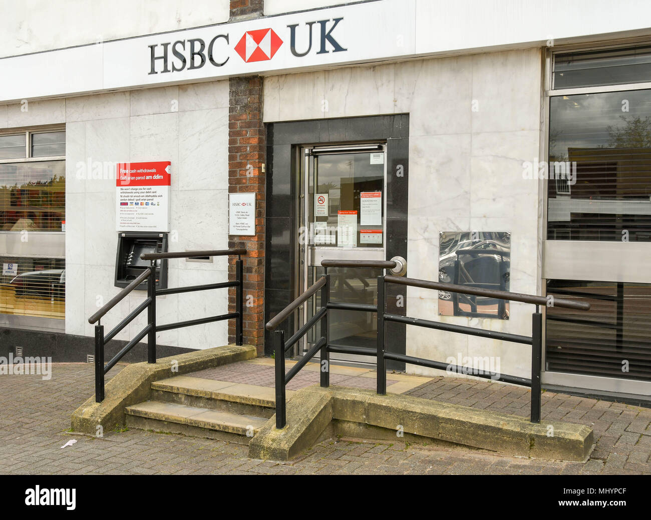 Exterior of a branch of HSBC Bank showing a ramp installed to provide easy access for disabled persons - Stock Image