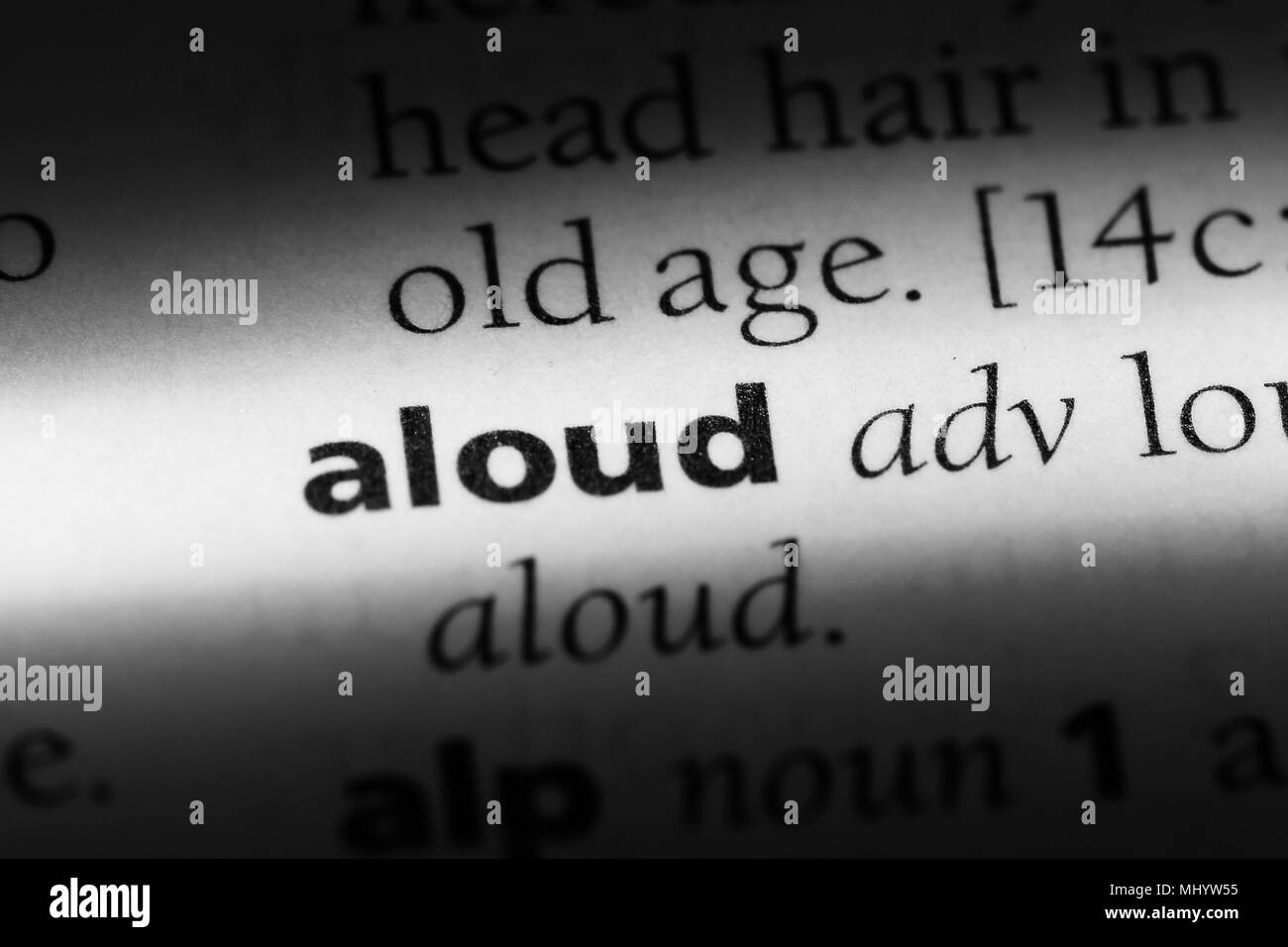 aloud word in a dictionary. aloud concept. - Stock Image