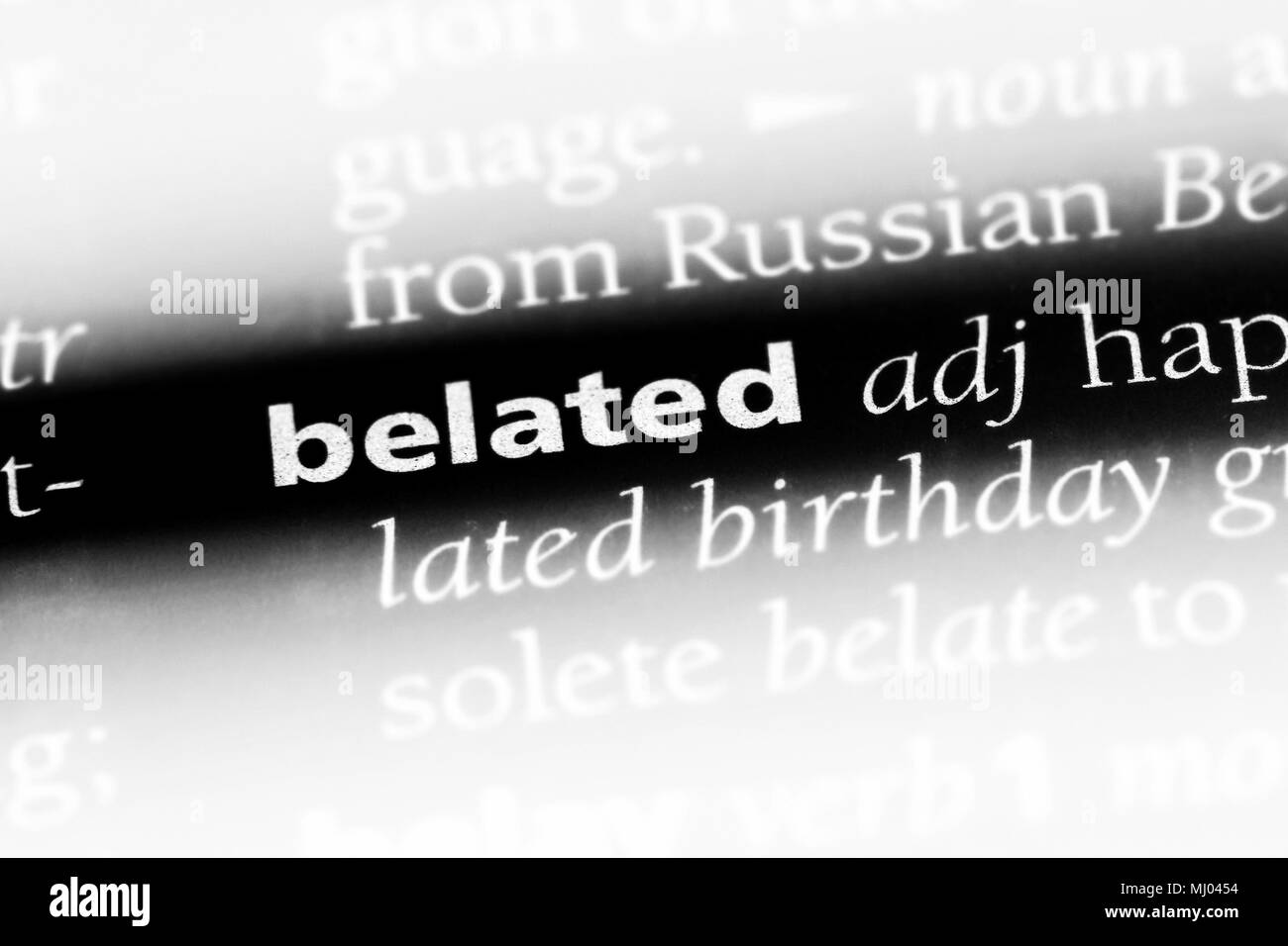 belated word in a dictionary. belated concept. - Stock Image