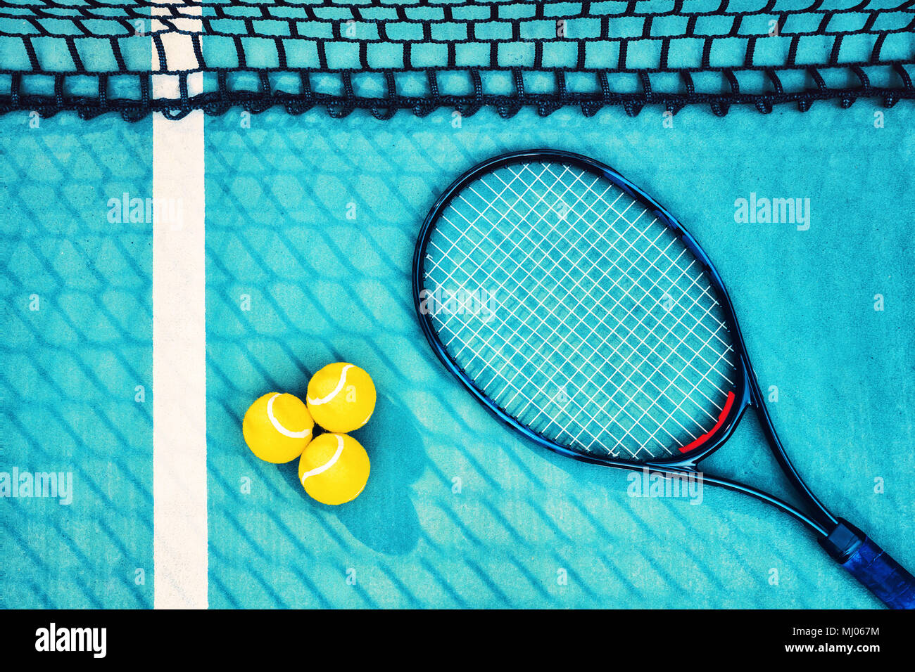 Top Down View Of Tennis Racket Net And Balls On Green Concrete