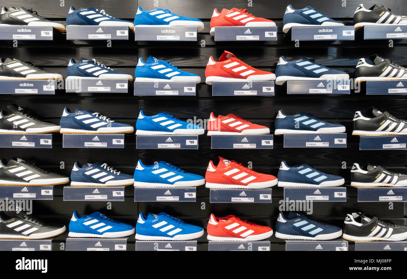 Adidas training shoes in Sports Direct store. UK Stock Photo - Alamy
