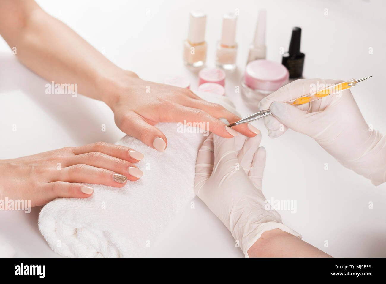 Woman hands in a nail salon receiving manicure with professional ...