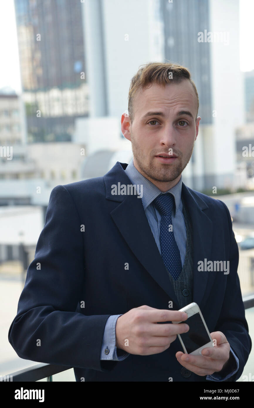 confident businessman with smartphone Stock Photo