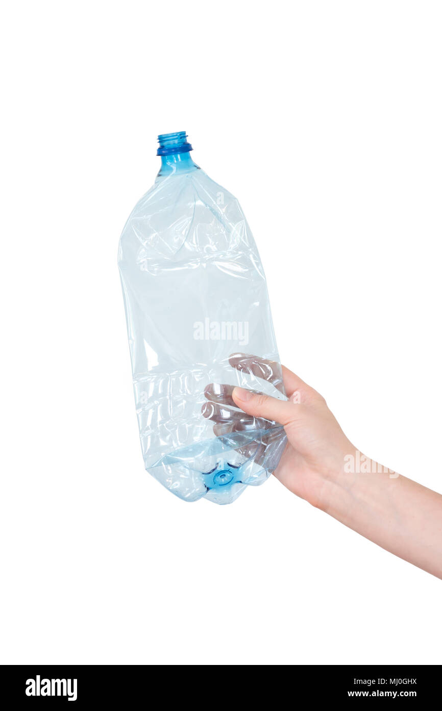 Female hand holding empty crushed blue plastic bottle isolated on white. Recyclable waste. Recycling, reuse, garbage disposal, resources, environment and ecology concept - Stock Image