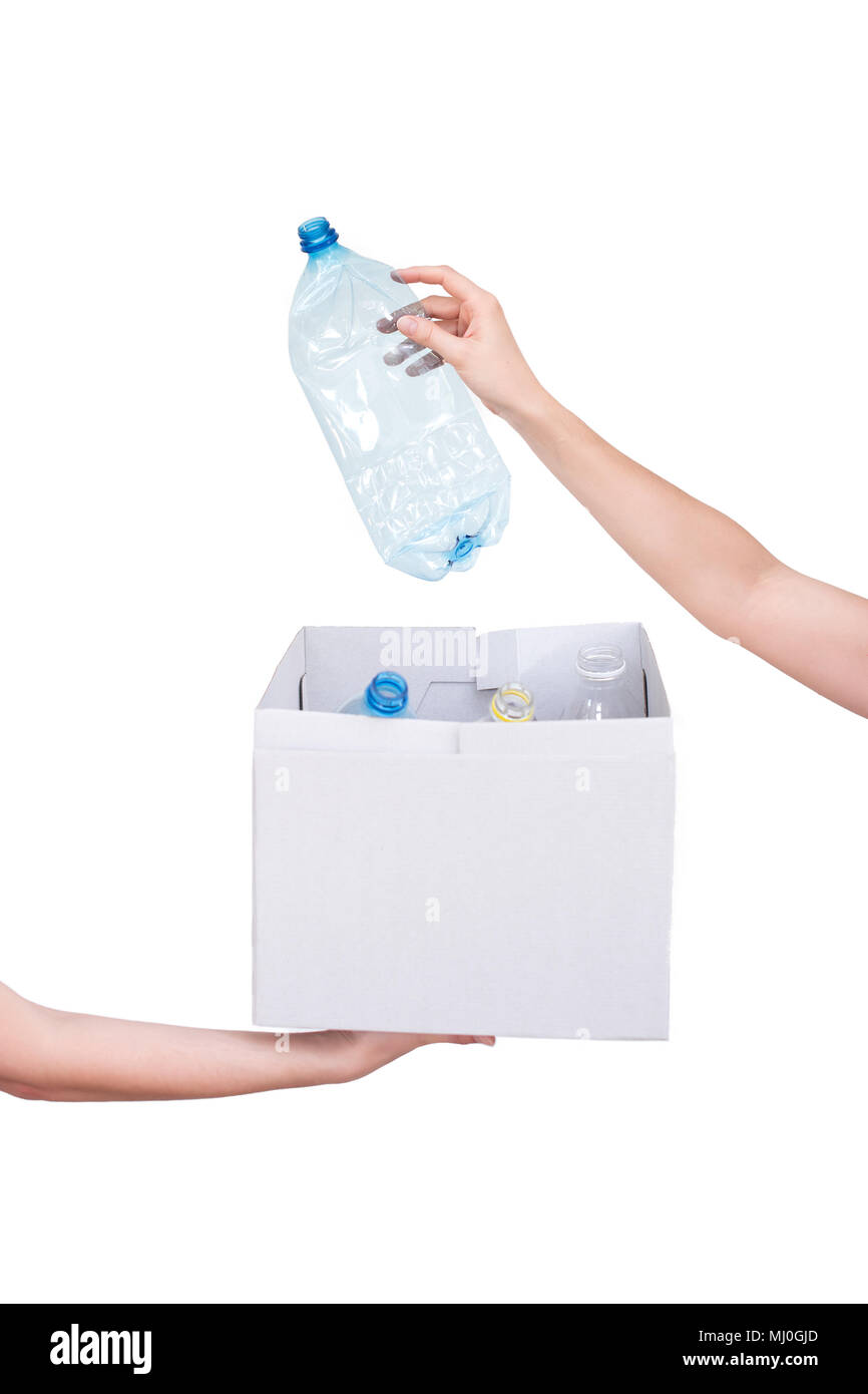 Female hands holding empty crushed blue plastic bottle isolated on white. Recyclable waste. Recycling, reuse, garbage disposal, resources, environment and ecology concept - Stock Image