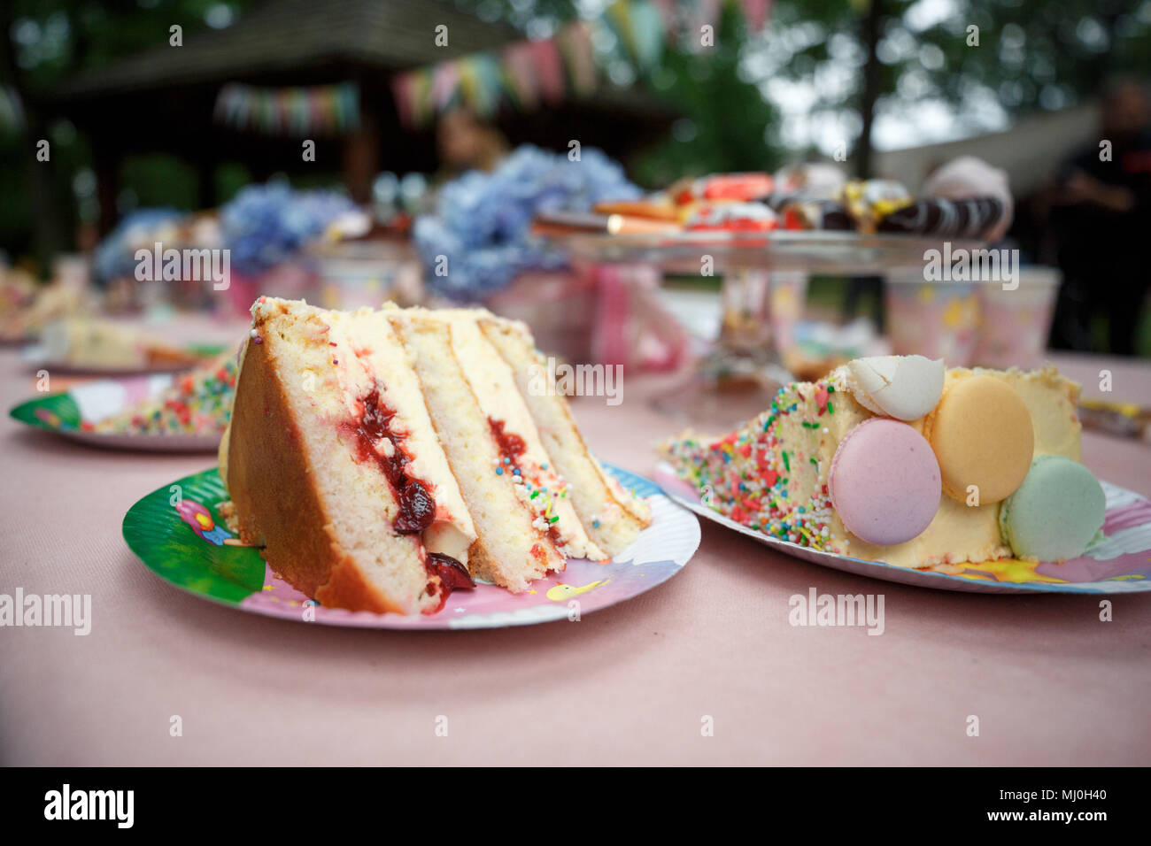 Delicious wedding reception candy bar dessert table full with cakes - Stock Image
