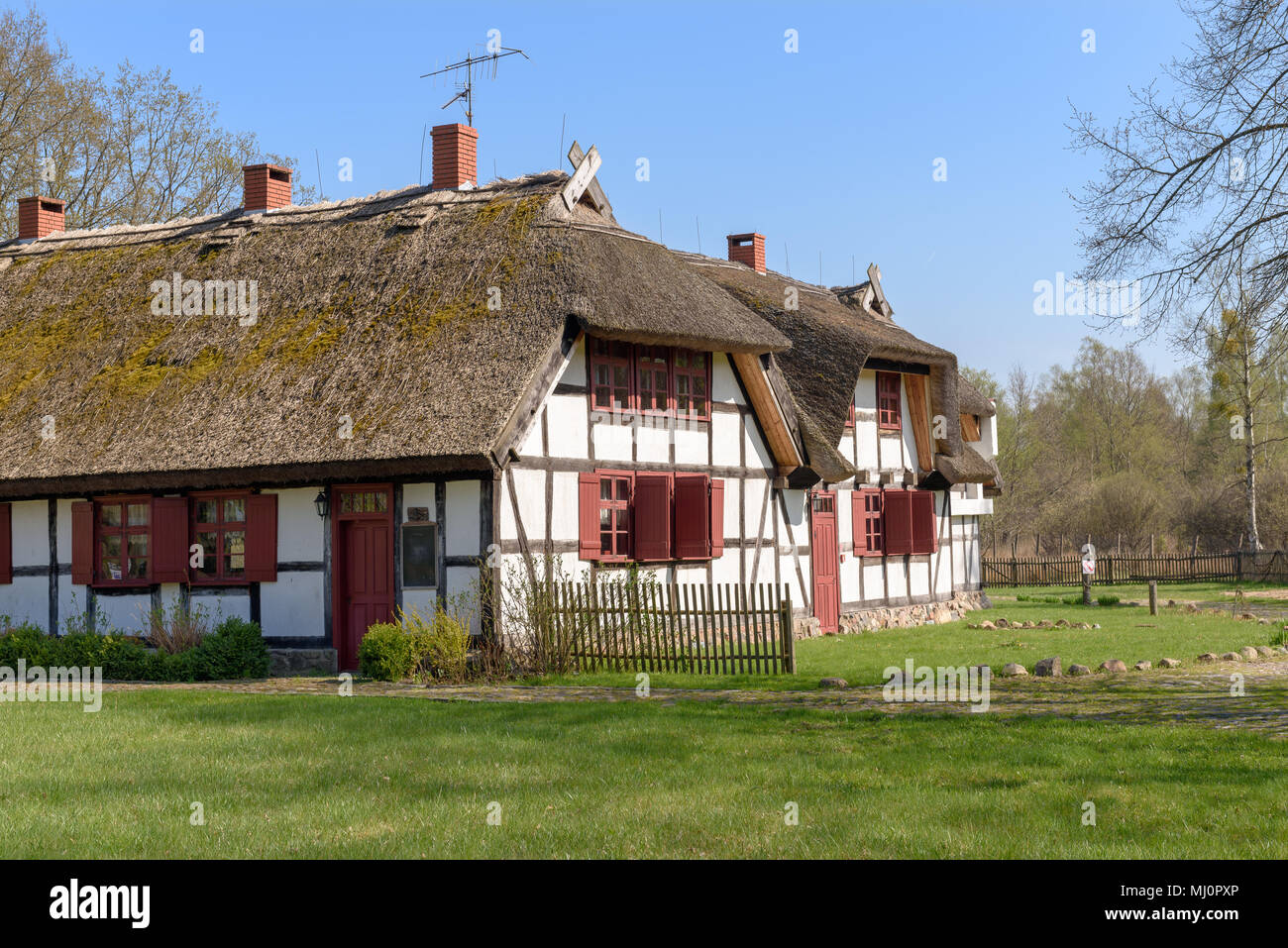 Typical traditional Polish country thatched house with ...