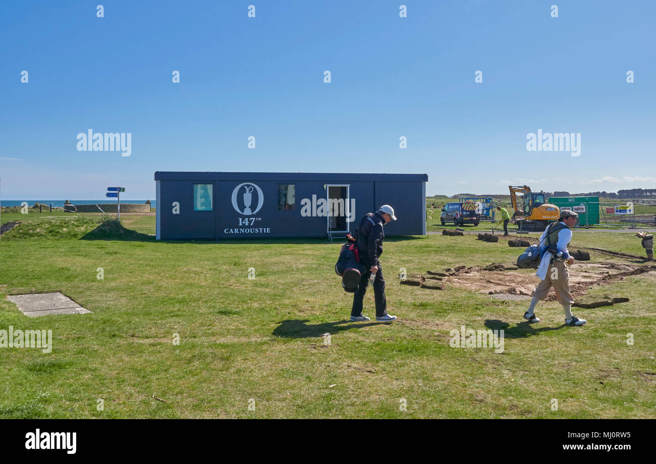 Golfers pick their way through the Preparation works for the 147th Open Golf Championships on their way to the 1st Tee in Carnoustie, Angus, Scotland. - Stock Image