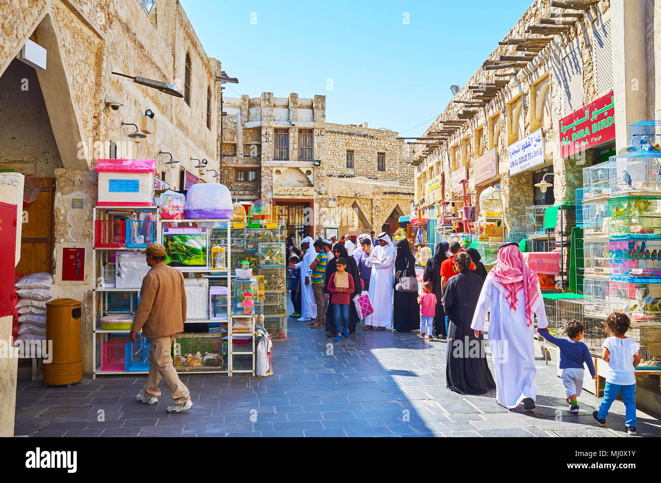 DOHA, QATAR - FEBRUARY 13, 2018: The Pet Market, of Souq Waqif with crowd of locals, looking for interesting birds or pets for children, on February 1 Stock Photo