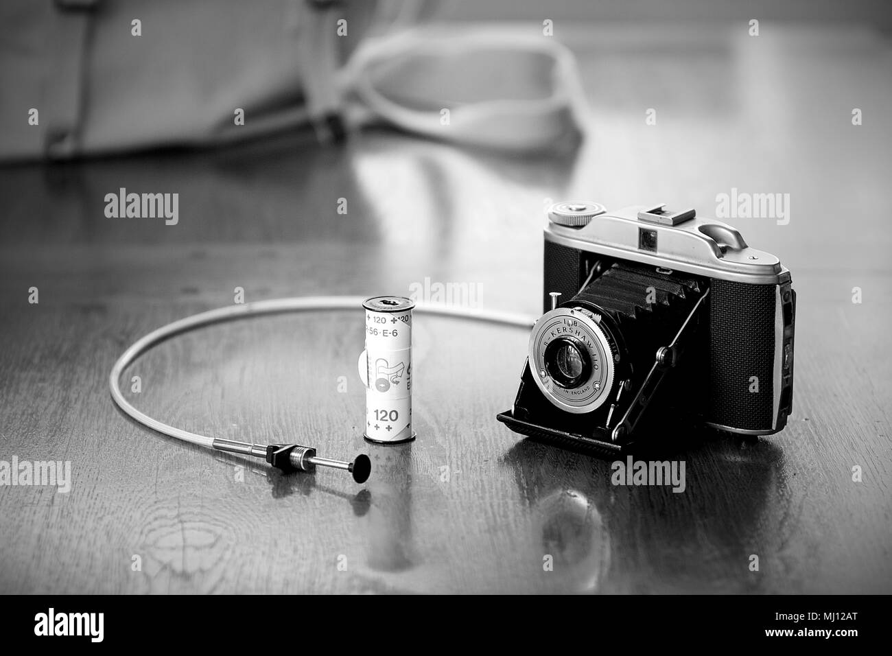 A G.B. Kershaw 110 Camera using 120 film plus a roll of 120 film and a cable release. - Stock Image
