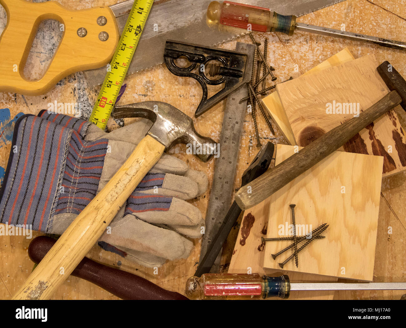 A collection of tools sitting on a workbench ready to be used - Stock Image