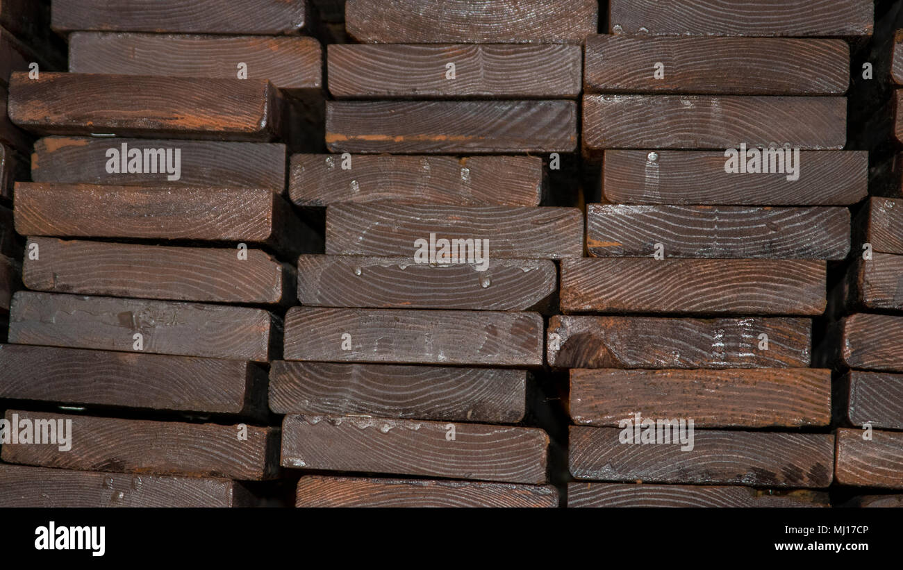 A pile of wooden planks - Stock Image