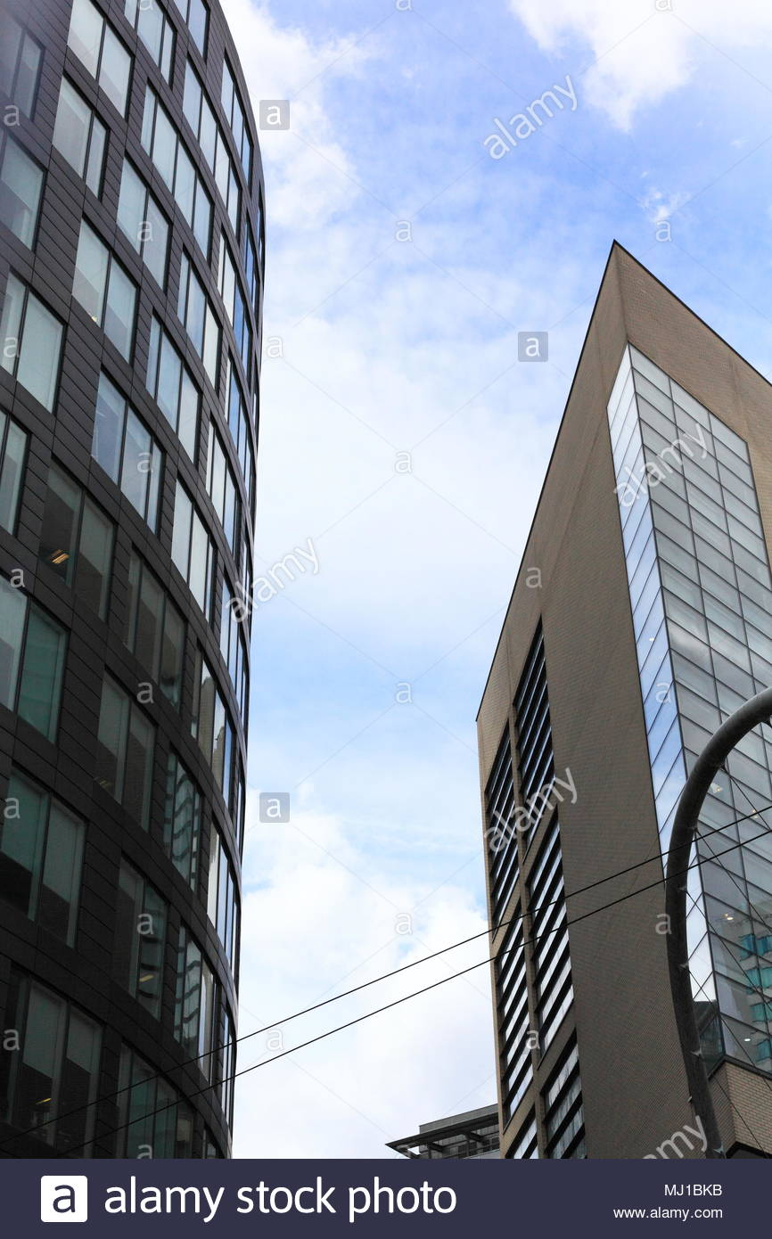 Modern Architecture High Rise Buildings With Glass Windows And Cladding In Manchester City Centre England May 2018 - Stock Image