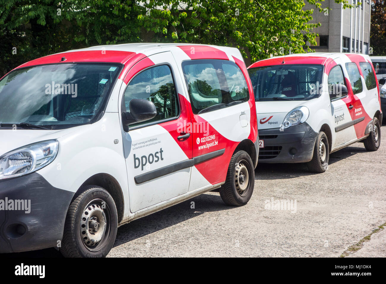 Red-white post delivery cars from Bpost, Belgian company responsible for the delivery of national and international mail - Stock Image