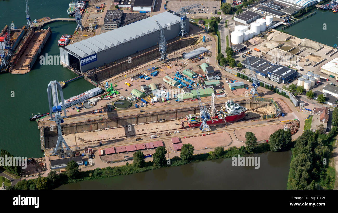 ROTTERDAM, THE NETHERLANDS - SEP 2, 2017: Aerial view of a ship in a repair dry dock in the industrial port of Rotterdam. - Stock Image