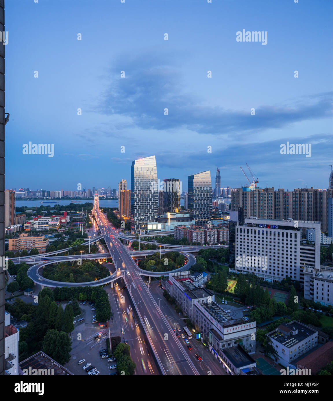 Wuhan, hubei province huangpu east and city construction at night - Stock Image
