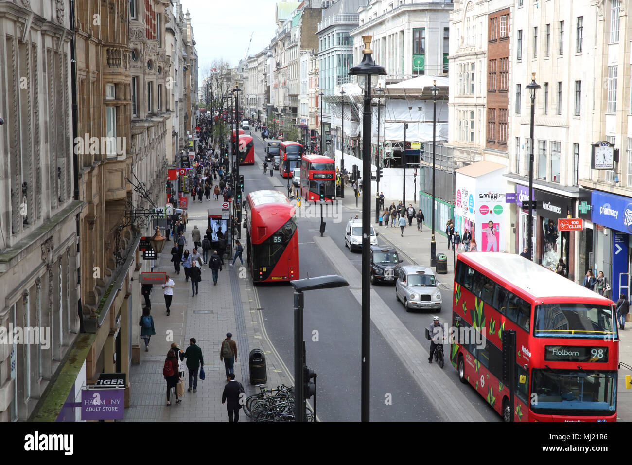 Buses and other traffic on Oxford Street at east end near Tottenham Court Road, in London, UK. - Stock Image