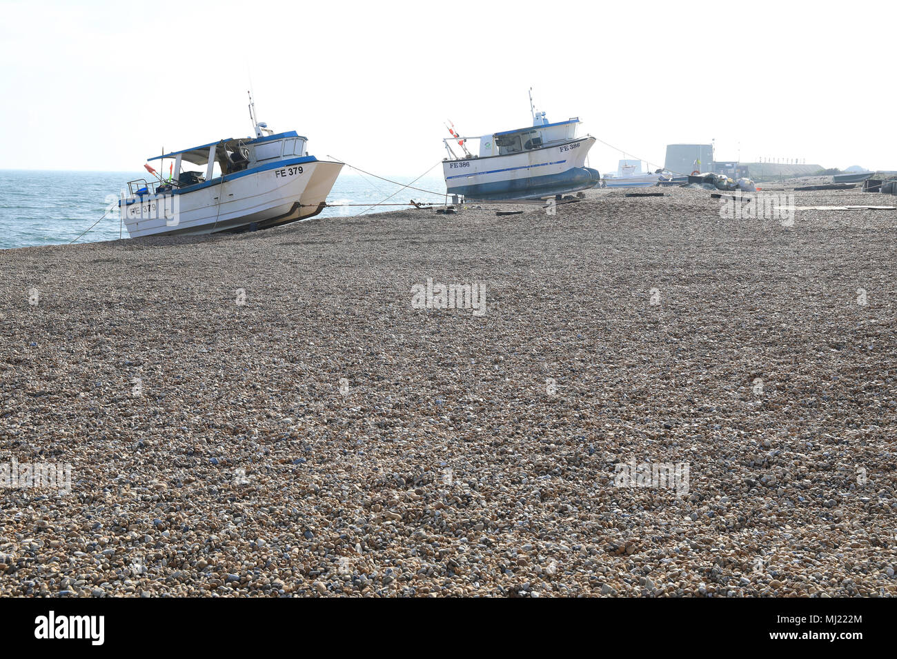 Fishing boats on the pebble beach in Hythe, near Folkestone, Kent, UK - Stock Image