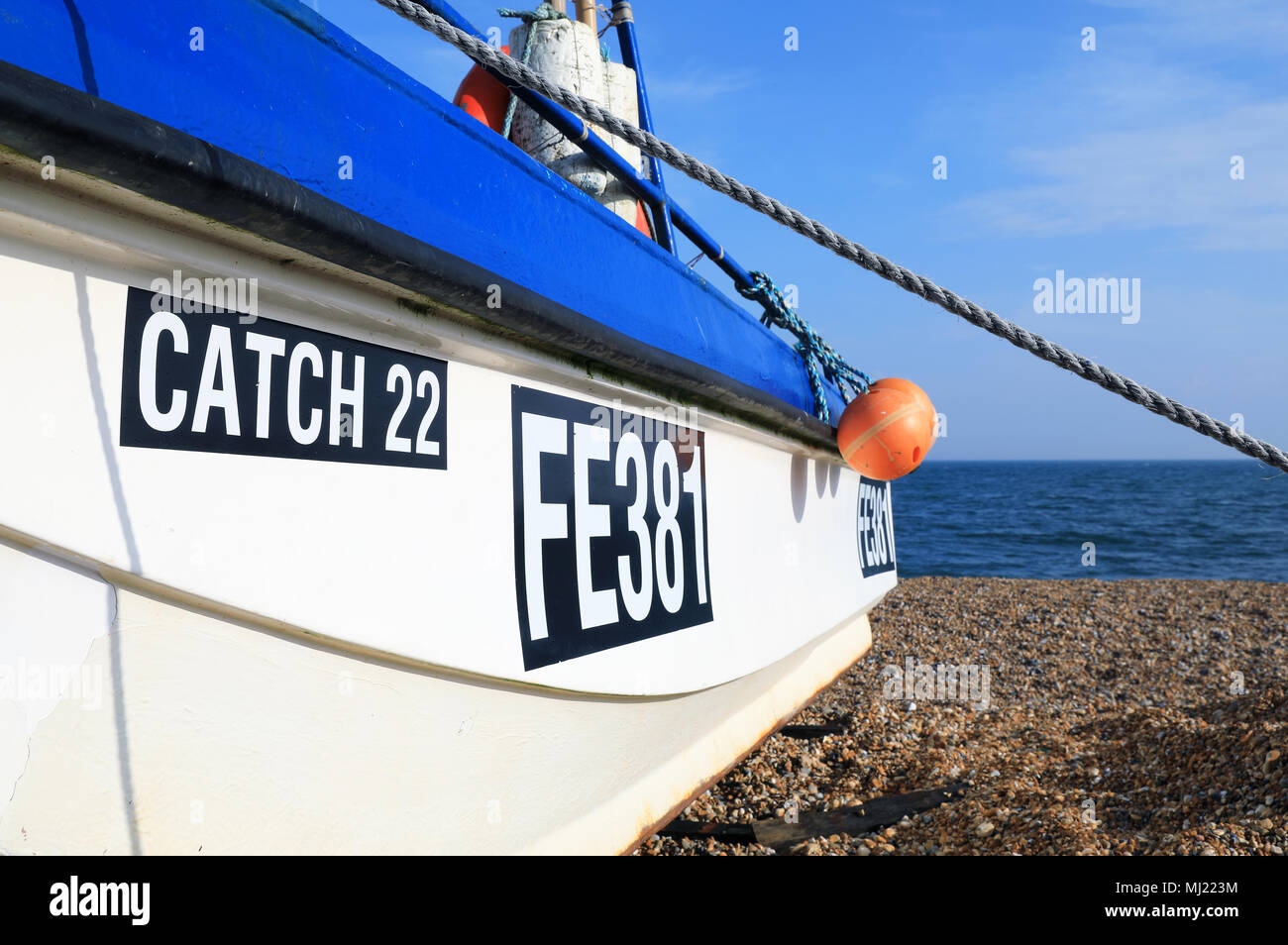 Fishing boat on the pebble beach in Hythe, near Folkestone, Kent, UK - Stock Image