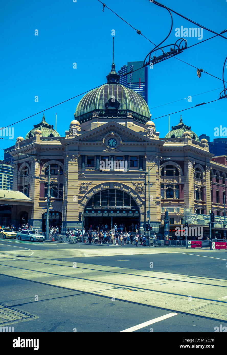 Desaturated cross processed image of entrance to Flinders Street Station at corner of Swanston St. and Flinders St., Melbourne, Australia - Stock Image