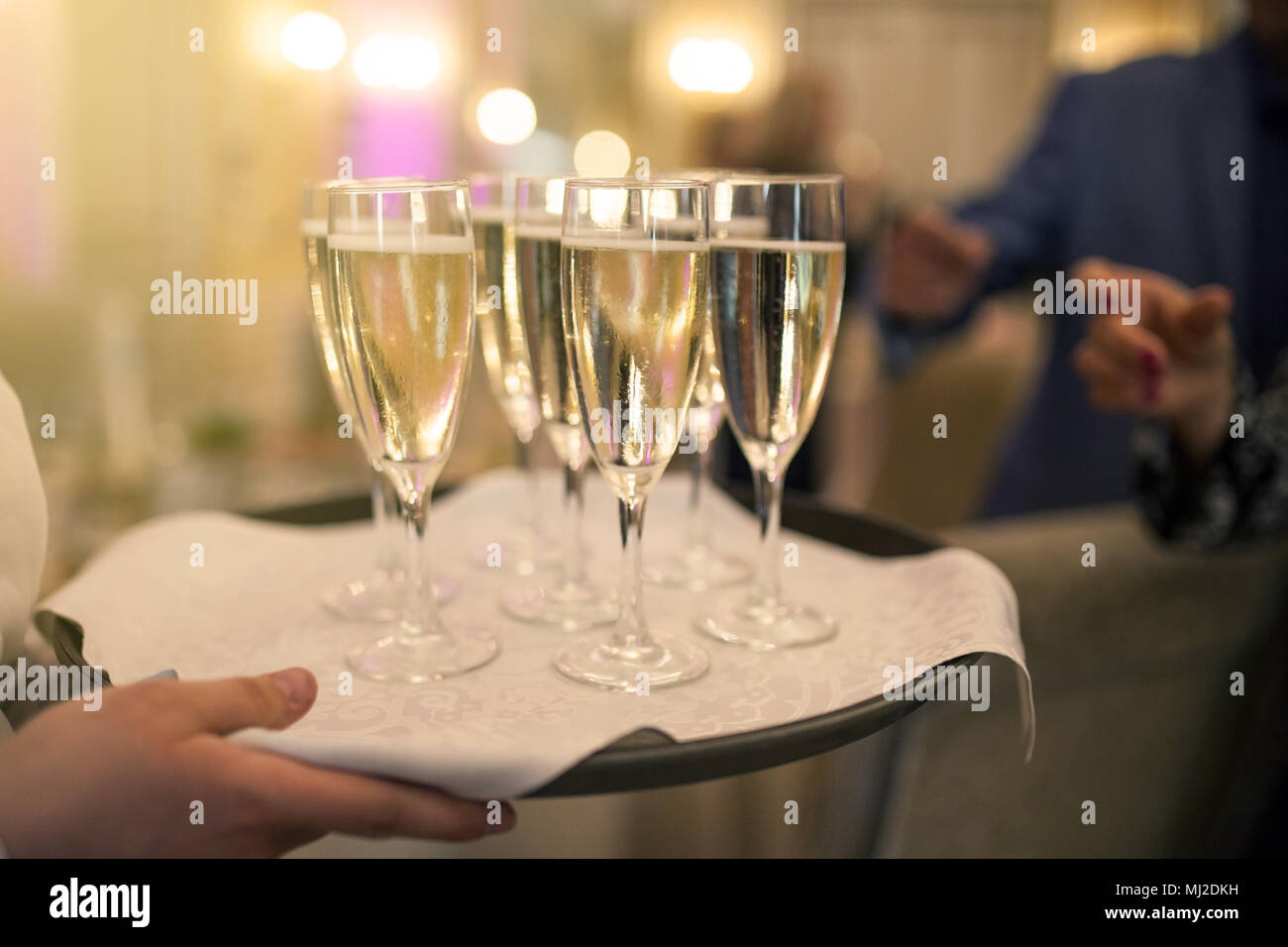 Waiter with glasses of champagne - Stock Image